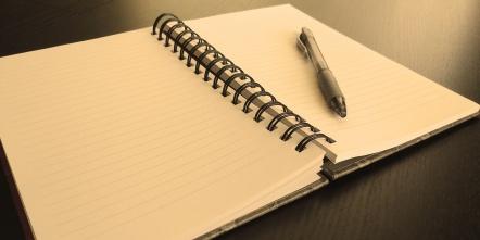 open-blank-notebook-in-sepia